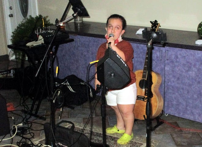 Erin Laming croons a tune Oct. 14 at the new Wednesday Night Open Mic at Boneyard BBQ at Carbone's Beachside in Sylvan Beach. The 12-year-old is a seventh-grader at Otto Shortell Middle School in Wampsville.