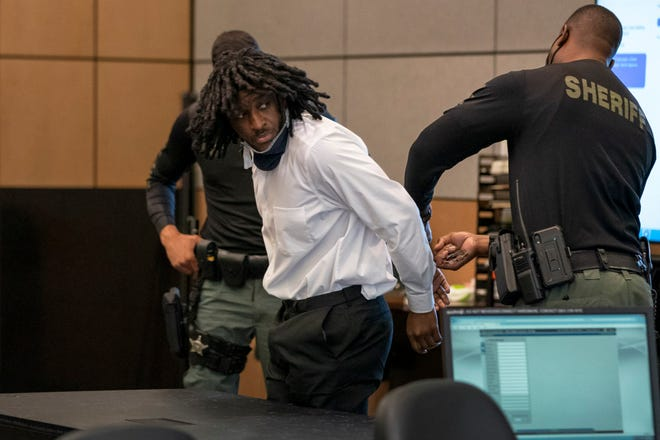 Marlin Joseph, the man convicted in 2017 West Palm Beach fatal shootings of Kaladaa Crowell and her 11-year-old daughter, Kyra Inglett, is handcuffed after his pre-sentencing hearing in the Palm Beach County Courthouse on  October 16, 2020 in West Palm Beach, Florida. (GREG LOVETT / The Palm Beach Post)