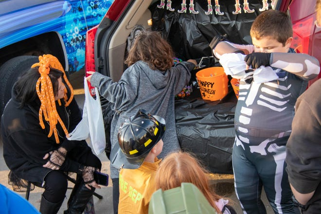 Area kids pick up candy during the Woodward Trunk or Treat event in 2019.