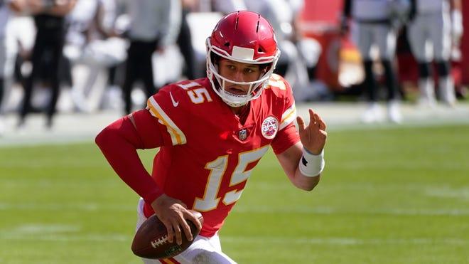 Kansas City Chiefs quarterback Patrick Mahomes runs the ball against the Las Vegas Raiders during the first half on Sunday, Oct. 11, in Kansas City.