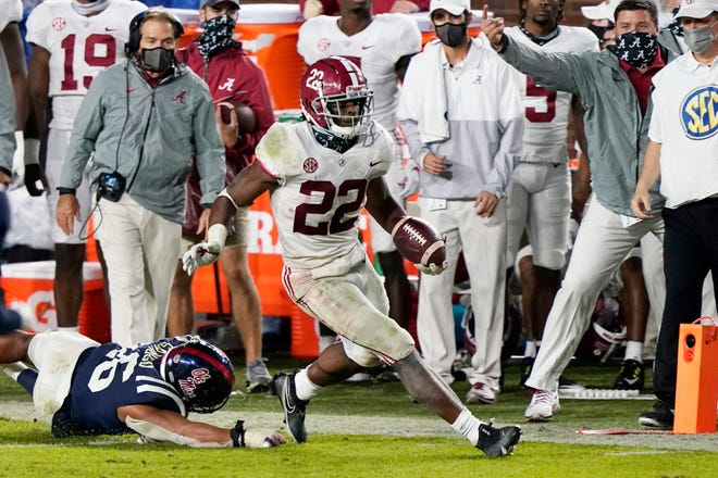 Alabama running back Najee Harris (22) runs past Mississippi linebacker MoMo Sanogo for a touchdown during the second half of last Saturday's game in Oxford, Miss. Second-ranked Alabama hosts No. 3 Georgia on Saturday.