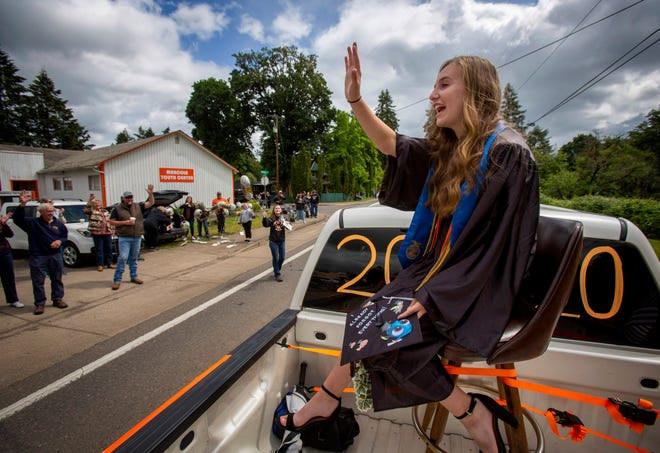 Mohawk High School valedictorian and student council president Peyton Robinson waves to friends and families of students as the Class of 2020 drives through Marcola during the class's graduation celebration, which was non-traditional because of COVID-19. Graduation rates was one of the few metrics the state was able to track for its annual school report card report.