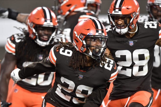 Browns safety Sheldrick Redwine (29) celebrates his interception during against the Indianapolis Colts, Sunday, Oct. 11, 2020, in Cleveland. The Browns won 32-23. [David Richard/Associated Press file]