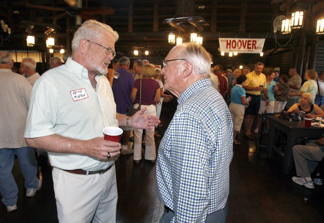 Former Hoover Presidents Keith Minton, left, and Frank Vaughn speak to each other during a reunion of former Hoover employees at Hoover Park in August 2012.