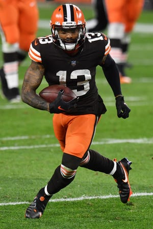 Browns wide receiver Odell Beckham Jr. runs with the ball during the first half against the Cincinnati Bengals last month.