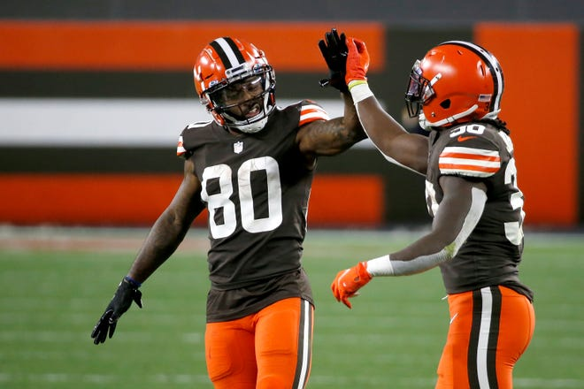 Cleveland Browns wide receiver Jarvis Landry (80) high fives running back D'Ernest Johnson (30) during an NFL football game against the Indianapolis Colts, Sunday, Oct. 11, 2020, in Cleveland. (AP Photo/Kirk Irwin)