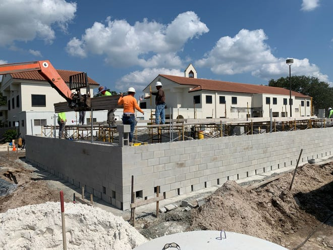 Workers with Willis Smith Construction have begun building the walls of Fire Station 1 as part of the Venice City Hall expansion. The $11.94-million project includes a new fire station and a new wing on City Hall for the building department.