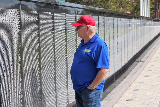 Bill Akins, executive director of Welcome Home Veterans 2020, pauses to reflect at the Vietnam Memorial Wall of Southwest Florida, which is located at 100 Nesbit Street, Punta Gorda.