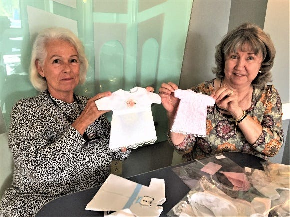 Norma SanClemente and Jackie Davis transform discarded bridal gowns into bereavement garments. [CONTRIBUTED PHOTO]