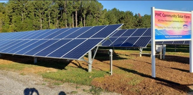 The Fayetteville Public Works Commission holds a ribbon-cutting for a solar farm in October of 2019 at the Butler-Warner Power Generation Plant. The farm is part of the utility's Community Solar program.