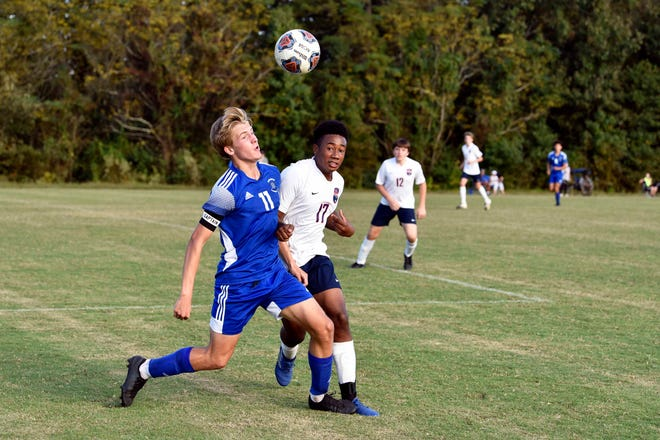 Fayetteville Christian's Coyle Garcia battles Freedom's Lyrik Thompson in the NCISAA Sandhills Conference championship game on Oct. 15, 2020 at Jordan Soccer Complex. Fayetteville Christian won 3-2.