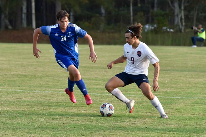 Freedom Christian's Reynaldo Molina (right) has been named the NCISAA Sandhills Conference Boys' Soccer Player of the Year for the 2020-21 season.