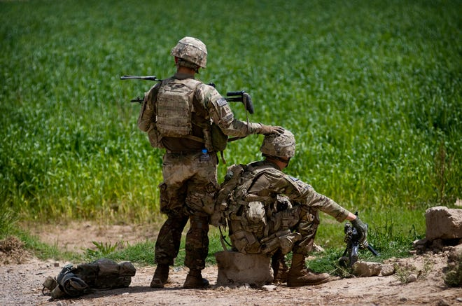 Pfc.  Jonathan Bodine, left, and Pfc. Christopher Deal of 1st Platoon, D Company, 2nd Battalion, 508th Parachute Infantry Regiment, 4th Brigade Combat Team, pull security at Gran Mama bridge in Sartek while scouting the location for an Afghan local police strong point.