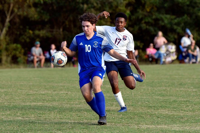 Freedom Christian's Lyrik Thompson (17) chases down Fayetteville Christian's Cannon Baker in the NCISAA Sandhills Conference championship game on Oct. 15 at the Jordan Soccer Complex. The City Council has approved a lease agreement in which the city can use the complex for tournaments and public use.