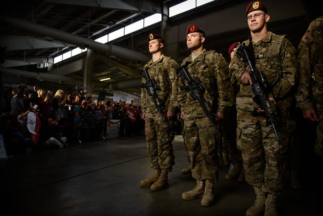 Paratroopers from the 1st Battalion, 504th Parachute Infantry Regiment, stand at attention Nov. 5, 2014, on Pope Army Airfield. About 300 paratroopers arrived at Fort Bragg from a nine-month deployment in Afghanistan.