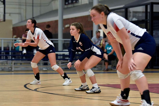 Freedom Christian players, from left, Hadley Jackson, Addison King and Allie Morse get ready to defend against Northwood Temple during the NCISAA Sandhills Conference championship on Thursday, Oct. 15, 2020, at Freedom Courts Sportsplex.