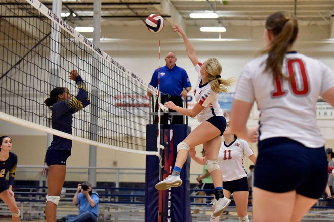 Freedom Christian Academy's Kendell Williams goes up for a kill during the NCISAA Sandhills 2-A tournament championship against Northwood Temple Academy on Thursday, Oct. 15, 2020, at Freedom Courts Sportsplex.