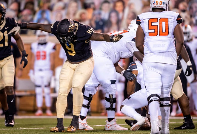 Wake Forest defensive lineman Carlos Basham Jr. takes a bow after sacking Campbell quarterback Hajj-Malik Williams.