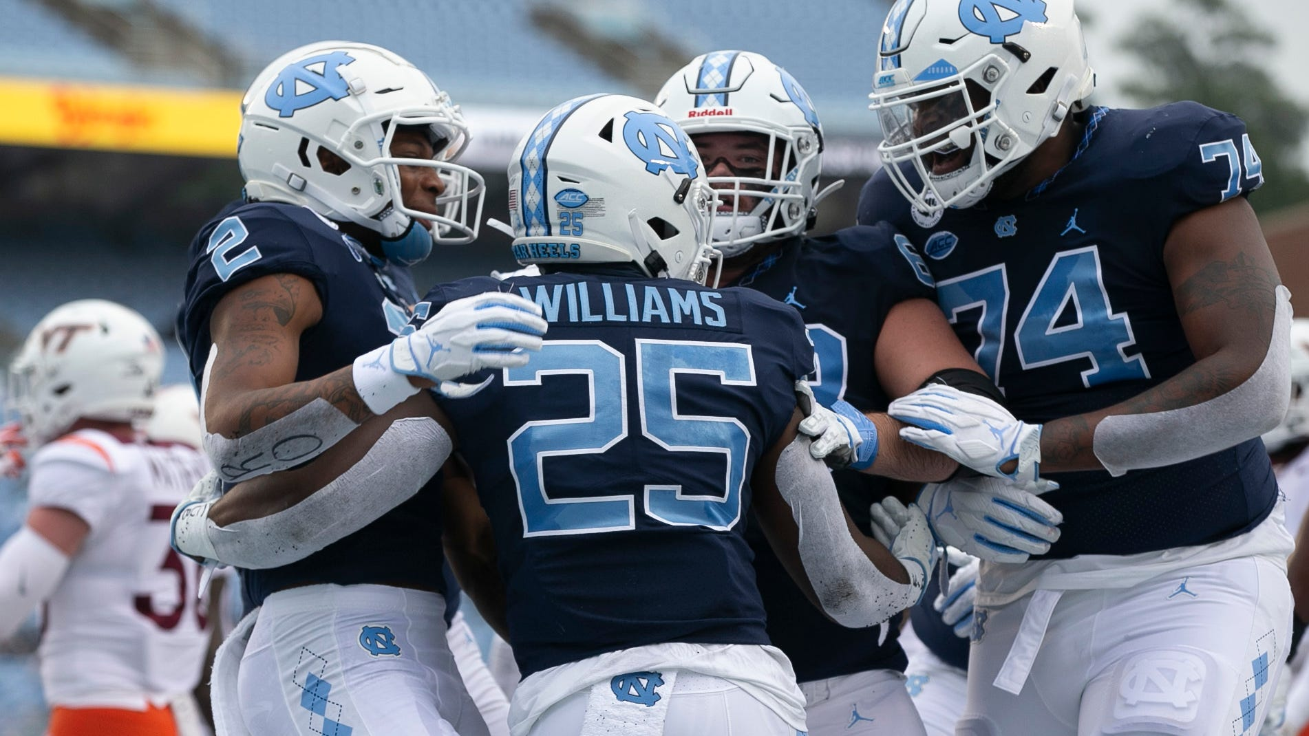 Running back Javonte Williams celebrates with North Carolina teammates including receiver Dyami Brown, left, and offensive lineman Jordan Tucker, right, after scoring last week against Virginia Tech.