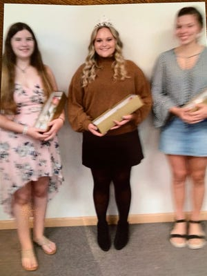 Camie Ford (left), Rose Queen Raegan Fitzgerald and Rachel Paden make up the 2020 Rose Queen Court of the New Philadelphia Lions Club.