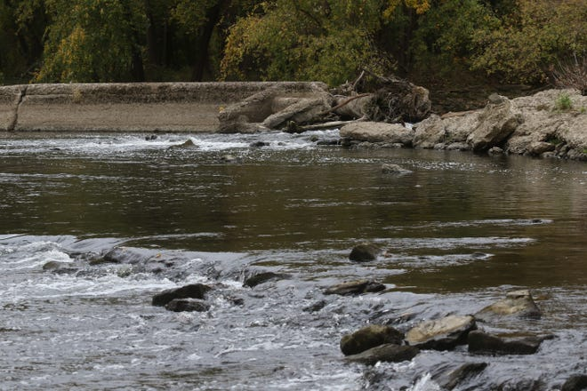 Water flows along the Zoar Dam during a quiet day on the Tuscarawas River.