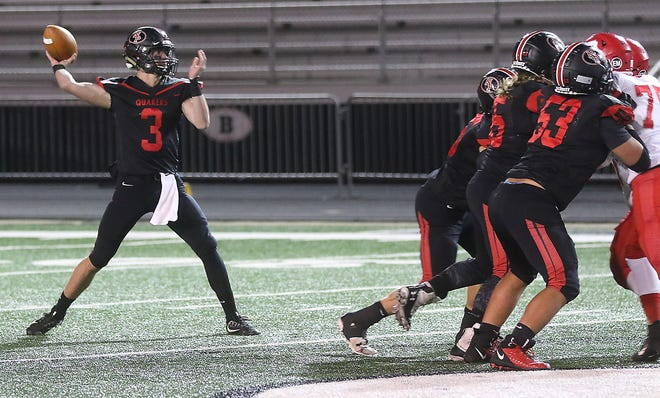 New Philadelphia's quarterback Caden O'Neill     throws a pass in the first quarter of the Division III  Regional second round Friday.