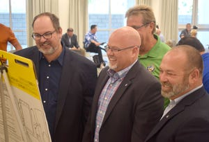 Councilman Michael Jarman (left) is seen alongside Mayor Mark Sheldon and Vice Mayor Geoff McConnell.