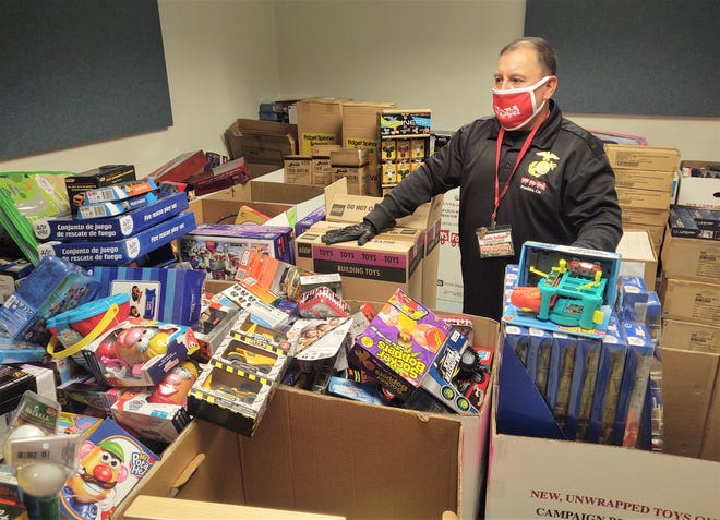 Freddie Gallegos Jr., coordinator for the local Toys for Tots program, readies gifts to be distributed Friday.
