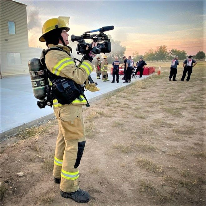 """Scott Mislan, who is embedded with the Pueblo Fire Department as part of """"Live + Rescue,"""" films a joint training exercise in the county."""