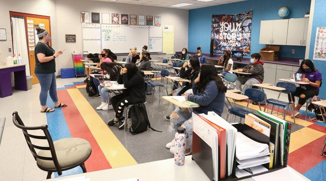 The 2020 school year has presented difficult challenges for teachers in Tuscaloosa City and Tuscaloosa County school systems. Haleigh Junkin teaches her seventh grade English class at Davis-Emerson Middle School Oct. 13, 2020. [Staff Photo/Gary Cosby Jr.]