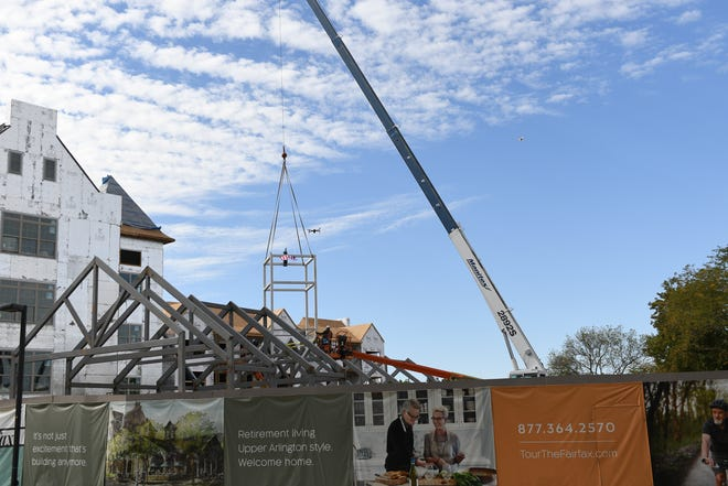 """A """"topping-out"""" ceremony was held Sept. 30 by National Church Residences for the expansion project at First Community Village, 1800-02 Riverside Drive. The Fairfax will be four stories and have 70 independent-living apartments."""