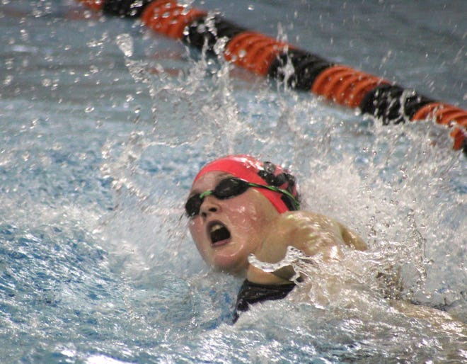 Wellsville's Kaylee Oswald swims a portion of the 500 freestyle relay Thursday against Dansville.