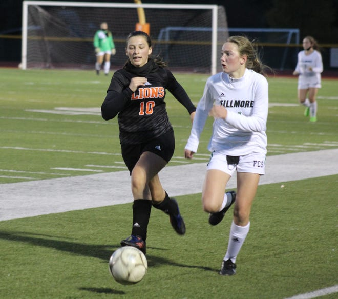 Fillmore's Rachel Hatch pushes the pace as Wellsville's Cynthia Covel  (10) pursues Thursday night.