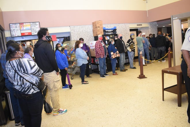 Voters lined up early at the Rapides Parish Courthouse in downtown Alexandria to cast their votes in the Nov. 3 presidential election. Voters waited about an hour.