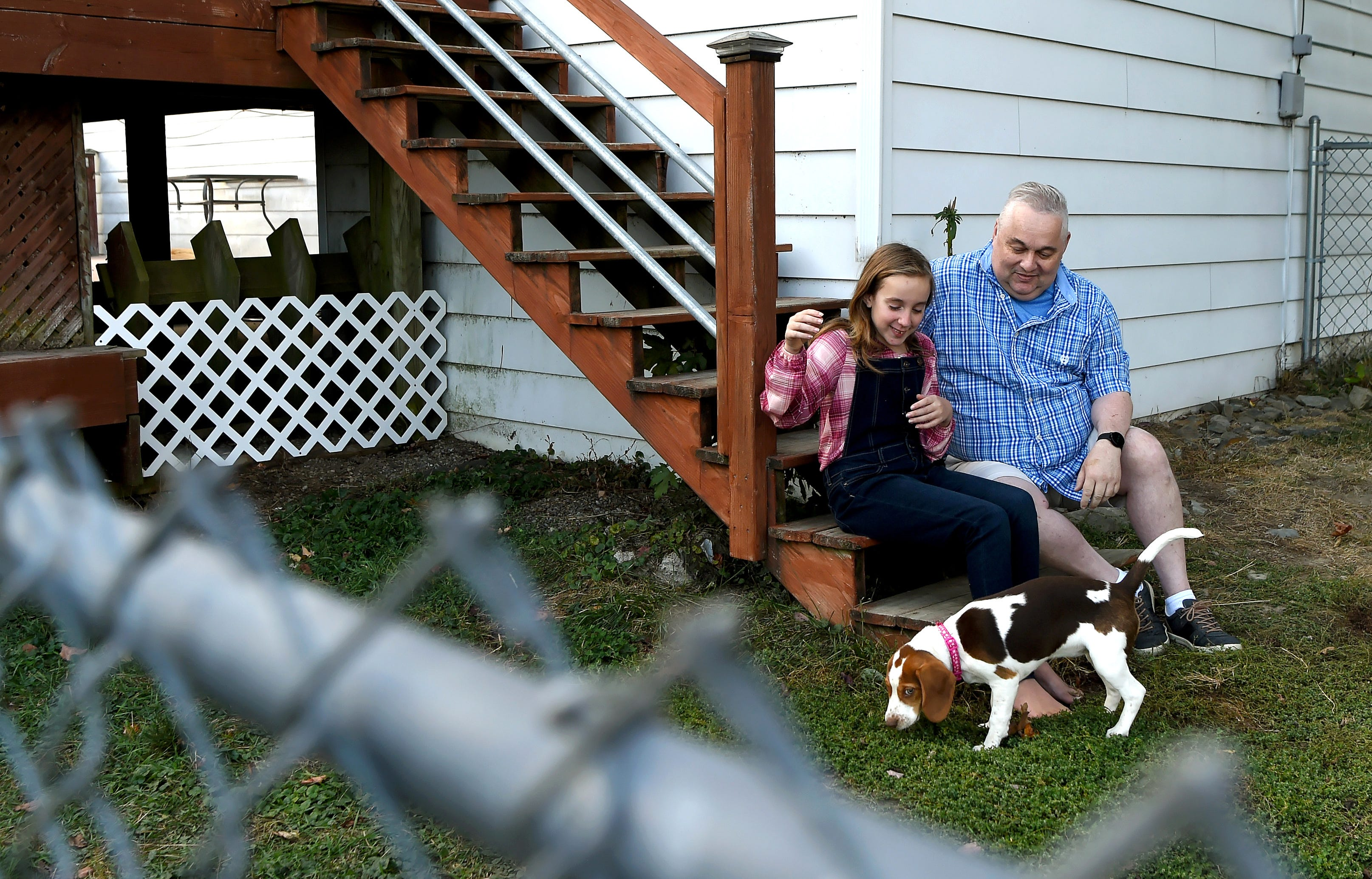 James Sova with his daughter Bella and puppy Daisy.