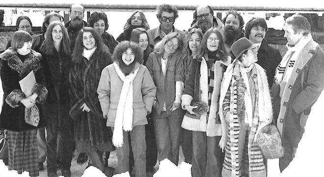 Founding members of the MFA Program for Writers. Louise Glück is pictured with a hat to the far-right.