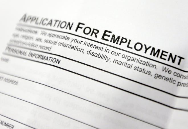 April 22, 2014, file photo shows an employment application form on a table during a job fair (AP Photo/Mike Groll, File)