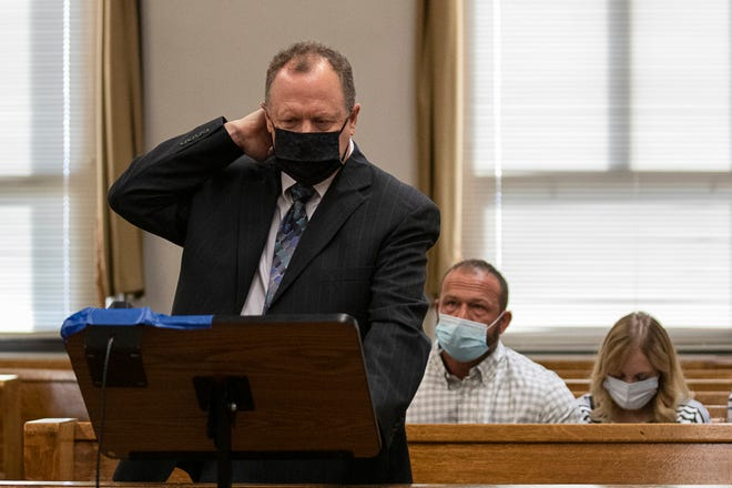 Jordan Buckley's parents listen as Fritz Schafer grabs the back of his neck to demonstrate the spinal chord injuries Victoria Schafer suffered after a tree log fell on Schafer and killed her while at Hocking Hills State Park during a senior shoot on Monday, Sept. 2, 2019.