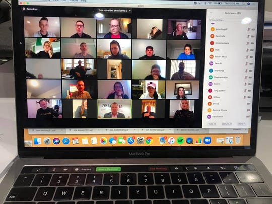 Employees in a Zoom meeting at Jeff Glover & Associates.