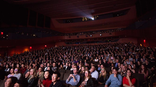 The New York Film Festival is a major hotspot for movie premieres where select audiences often fill theaters to watch highly-anticipated releases, as shown in the 2018 festival.