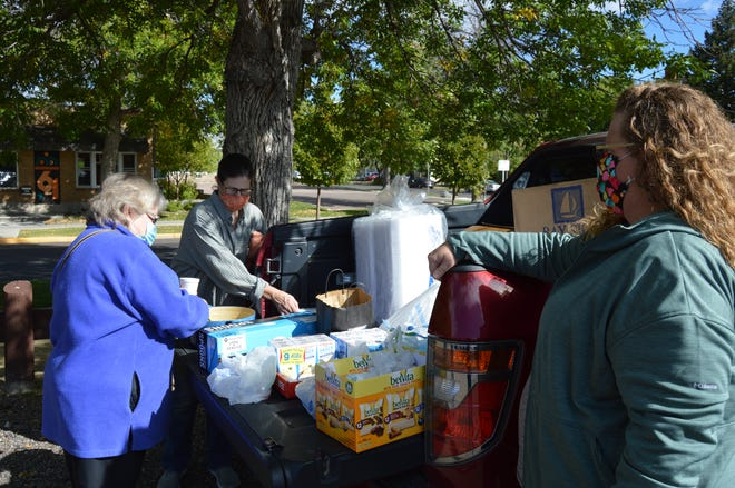 St. Vincent de Paul Director of Homeless Services Carley Tuss hands out meals to homeless residents Sunday through Thursday at 11 a.m. in the parking lot of First United Methodist Church. On Sundays, Susie McIntyre brings hot soup and Stephanie Cummings brings homemade cookies.