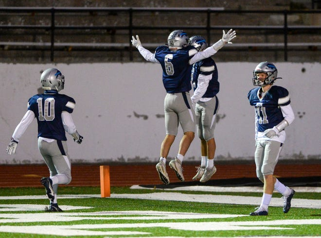 Great Falls High's Payton Gonser, no. 6, celebrates with Levi Torgerson after Torgerson's touchdown reception in the first quarter of Thursday's football game against Billings Skyview.
