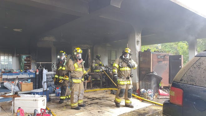 Firefighters respond to a structure fire on Chalan Luayao in Barrigada on Oct. 16, 2020.