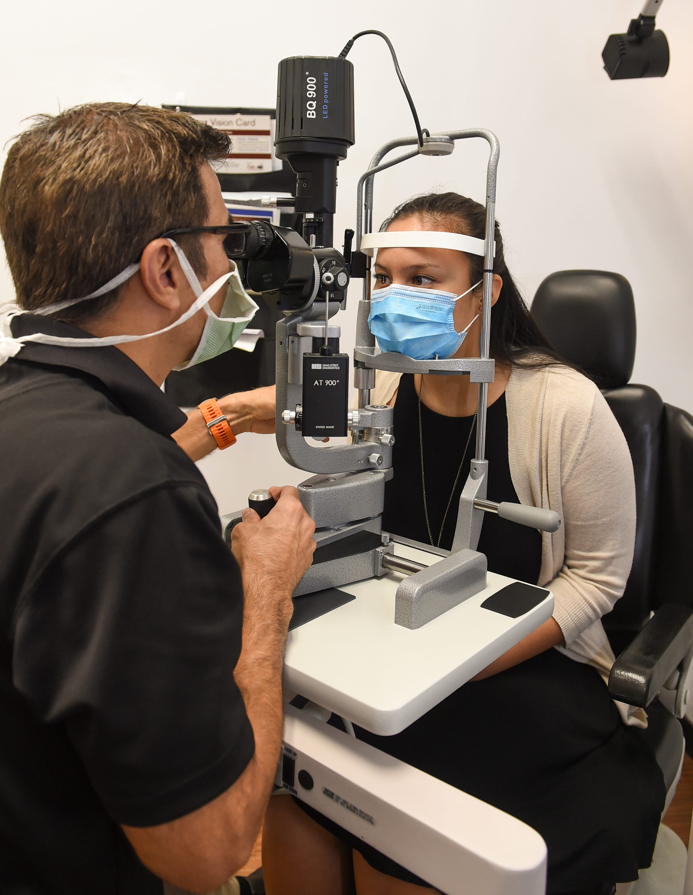 Dr. Peter Lombard performs a slit-lamp examination on Bryana Paulin at Lombard Health Eye Clinic and Optical Gallery in Sinajana, Oct. 16, 2020.