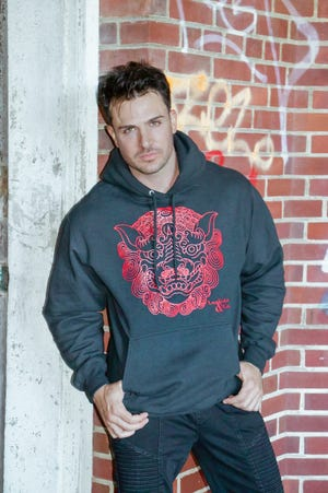 New York fashion model Philip Fusco models a Foo Dog Hoodie produced by Analista & Co. A portion of the sales price will go to Guam Lighthouse Recovery Center.
