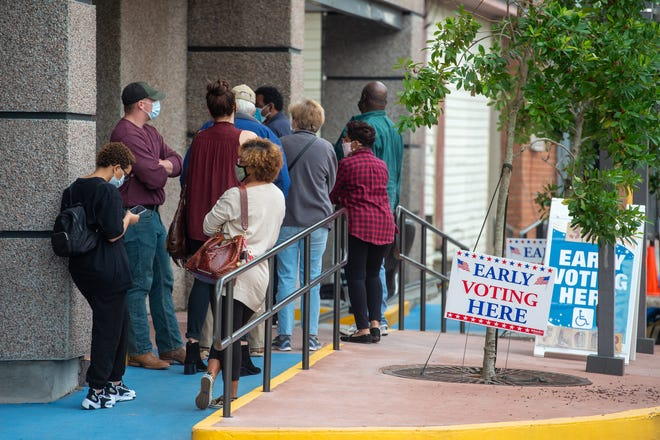 Early voters wait in line to vote in Lafayette, LA. Friday, Oct. 16, 2020.