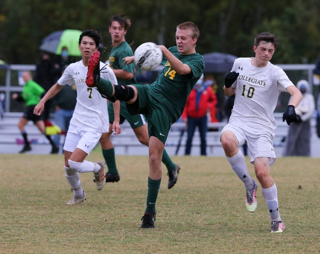 St. X's Noah Sirchio (14) kicked against Collegiate during the 26th District soccer championship at Championship Trace Athletic Complex in Louisville, Ky. on Oct. 15, 2020.  Collegiate won 3-1.