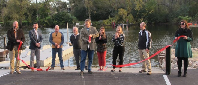 Thiensville officials cut a ribbon Oct. 6 to mark the opening of the upgraded boat launch. Pictured are, from left, Director of Public Works Andy LaFond, Village Engineer Jerad Wegner, Trustee Rob Holyoke, Village President Van Mobley, Trustee Kristina Eckert, Trustee Angelina Apostolos, Trustee David Lange and Village Administrator Colleen Landisch-Hansen.