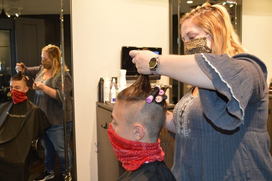 Spargo Salon & Spa hairstylist Hailey Van Hulst rolled Connor Macleod's hair with perm rods.