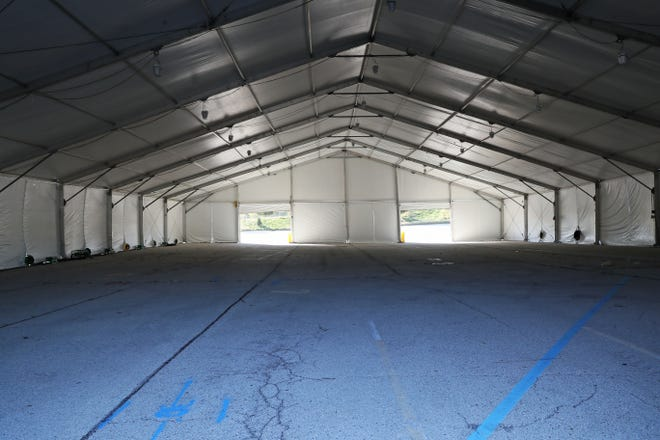 The cavernous interior of the tent to be used for the testing in a parking lot at Miller Park park. On October 19 testing for Covid19 will begin at Miller Park, staffed by the guard, the Health Department and the county EMS team.  The site will have a capacity of 1,500 to 2,000 tests each day.